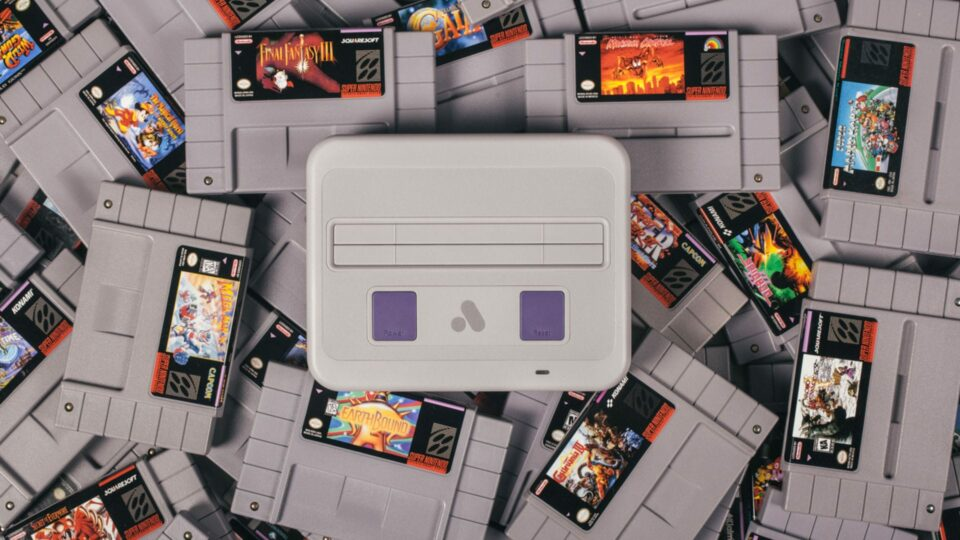 Analogue Super Nt sitting atop a bunch of SNES games